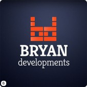 development company logo design orange dark blue